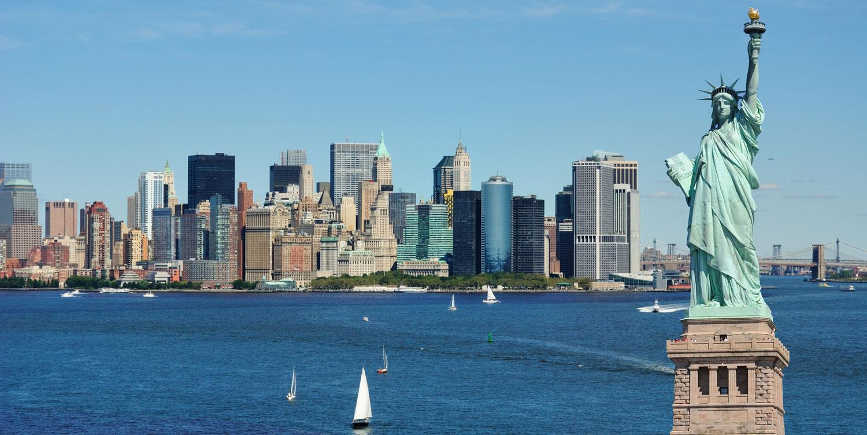 Liberty against skyline new york
